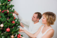Christmas tree couple royalty free stock photo