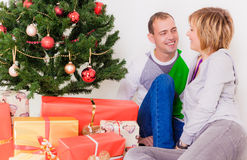 Christmas tree couple royalty free stock images