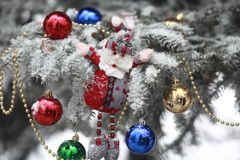 Christmas tree. Covered with snow and dressed toys stock photography
