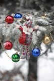 Christmas tree. Covered with snow and dressed toys royalty free stock images