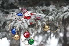 Christmas tree. Covered with snow and dressed toys royalty free stock photos