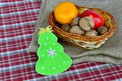 Christmas tree crafts. Christmas food. Fruits and walnuts. Kids craft Stock Photos