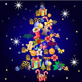 Christmas tree created with different chrismas gift items Stock Image