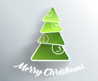 Christmas tree created from green papers. Royalty Free Stock Image