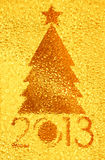 Christmas tree crystal golden background Stock Images