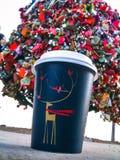 Christmas tree cup. Christmas coffee cup deer birds Stock Photography