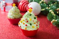 Christmas tree cupcake. And Christmas decoration stock photos