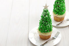 Christmas tree cupcake. Homemade christmas tree cupcake on white background royalty free stock photography