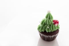 Christmas tree cupcake on white background. Christmas tree cupcake decorating with gift box on white background royalty free stock images