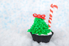 Christmas tree cupcake with white fondant frosting Royalty Free Stock Photo