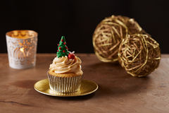 Christmas tree cupcake on Xmas background Stock Image