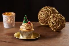 Christmas tree cupcake on Xmas background Stock Image