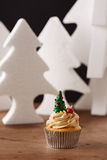 Christmas tree cupcake on Xmas background Royalty Free Stock Images