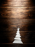 Christmas tree cut out from paper on background Stock Image