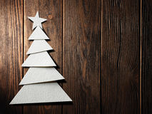 Christmas tree cut out from paper on background Royalty Free Stock Photo