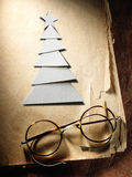 Christmas tree cut out from paper and glasses Royalty Free Stock Photos