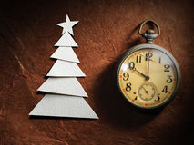 Christmas tree cut out from paper and vintage watch Royalty Free Stock Image