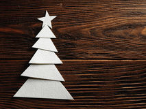 Christmas tree cut out from paper on a wooden background Royalty Free Stock Images