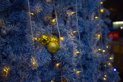 Christmas tree in December. Some Christmas gifts are piled by the Christmas tree in winter Stock Images