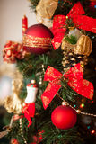 Christmas tree decor with red balls and bows Stock Images