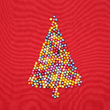 Christmas tree decorate by colorful beads on red Royalty Free Stock Photo