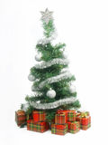 Christmas tree decorated. Christmas tree with presents over white Royalty Free Stock Image