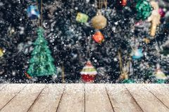 Christmas tree decorated abstract blur snow background with wood Stock Images