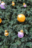 Christmas tree decorated with balls. Green pine needles of the Christmas tree with colorful toys and electric holiday garland Royalty Free Stock Images