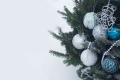 White, silver and blue baubles on a Christmas tree. A Christmas tree decorated with balls made of glass in white, silver and blue colors. White pearl beads on Royalty Free Stock Photography