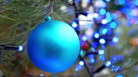 Christmas tree balls lights. Christmas tree decorated with balls in sparkling lights stock video footage