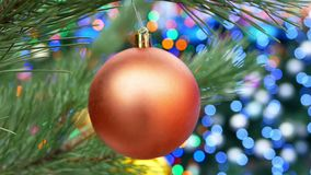 Christmas tree balls lights. Christmas tree decorated with balls in sparkling lights stock footage