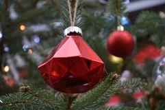 Decorative christmas tree for holidays Christmas and New Year`s. Christmas tree decorated with balls of various design and shapes and decorative elements Stock Images