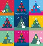 Christmas tree decorated with birds hearts bunny and snowman. In white, red, purple, blue, green, yellow colors a seamless pattern on a colorful background Stock Image