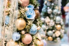 Christmas tree decorated with blue and gold balls. Closeup. Xmas decor, new year. Winter holiday celebration Royalty Free Stock Photos