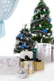 Christmas tree decorated with blue ornaments and presents Royalty Free Stock Photography