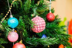 Christmas tree decorated with blue, pink and red balls royalty free stock photo
