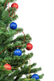 Christmas tree decorated with blue and red balls. Royalty Free Stock Images