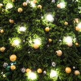 Christmas tree decorated with Christmas gold and silver ball han. Ging on tree with sparkling and twinkling lights in holiday and festive background Stock Photo