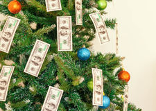 Christmas tree decorated with dollars notes Stock Photos