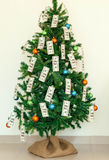 Christmas tree decorated with dollars notes Royalty Free Stock Image