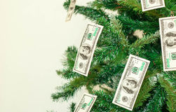Christmas tree decorated with dollars notes Stock Photo