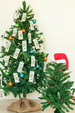 Christmas tree decorated with dollars notes Royalty Free Stock Photography