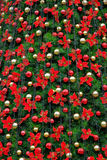 Christmas tree. Decorated with flowers Stock Images