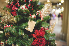 Christmas tree decorated with flowers Royalty Free Stock Images