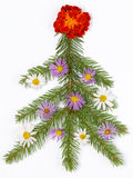 Christmas tree decorated with flowers Royalty Free Stock Image