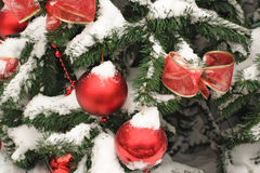 Christmas tree decorated in front of the house. Christmas tree with Christmas-tree decorations near house as background Royalty Free Stock Image