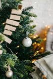 Decorated Christmas Tree garlands and balls lights. Christmas tree decorated with garlands and balls. Vertical shot royalty free stock photo