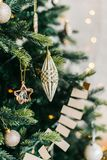 Decorated Christmas Tree garlands and balls lights. Christmas tree decorated with garlands and balls. Vertical shot royalty free stock image