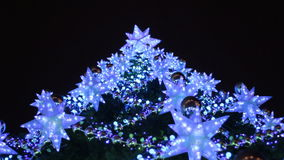 Christmas tree decorated with garlands and lanterns. Bottom view. Close-up. At night stock video footage