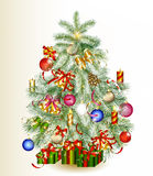 Christmas tree decorated by gifts and baubles Stock Photography